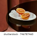cut orange with ice on a white... | Shutterstock . vector #746787460