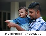 affectionate young man holds... | Shutterstock . vector #746802370