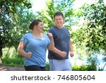 overweight couple running in... | Shutterstock . vector #746805604