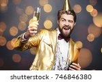man offering champagne and... | Shutterstock . vector #746846380