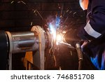 close up male auto mechanic in...   Shutterstock . vector #746851708