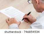 man signing a legal document | Shutterstock . vector #746854534