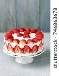 Small photo of Strawberry cake on cake stand.
