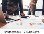businessman working with... | Shutterstock . vector #746869396