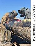 welders on the pipeline repairs | Shutterstock . vector #746877514