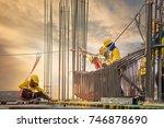 workers hands using steel wire... | Shutterstock . vector #746878690