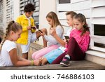 five young smiling kidsare... | Shutterstock . vector #746886103