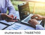 business team meeting present ... | Shutterstock . vector #746887450
