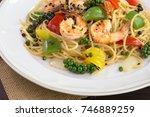 spaghetti prawns stir black... | Shutterstock . vector #746889259