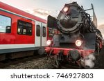 Old Steam Train And Modern...
