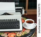 a typewriter and tea on an... | Shutterstock . vector #746940970