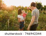parents and baby daughter... | Shutterstock . vector #746942344