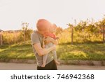 father and baby daughter... | Shutterstock . vector #746942368