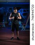 young male athlete bodybuilder... | Shutterstock . vector #746944720