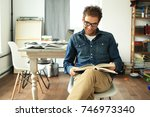 young man reading book on the... | Shutterstock . vector #746973340