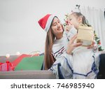 asian young mother presents... | Shutterstock . vector #746985940