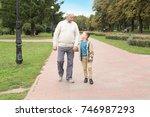 Elderly Man With Grandson In...