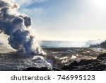 eruption of a volcano on the... | Shutterstock . vector #746995123