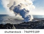 eruption of a volcano on the... | Shutterstock . vector #746995189