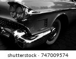 classic car with close up | Shutterstock . vector #747009574