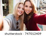 Two Pretty Smiling Girls Takin...