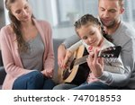 father teaching daughter how to ... | Shutterstock . vector #747018553