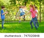 cute little children jumping... | Shutterstock . vector #747020848