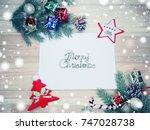 christmas background with fir... | Shutterstock . vector #747028738