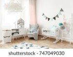 comfortable armchair standing... | Shutterstock . vector #747049030