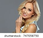 smiling beautiful blond woman | Shutterstock . vector #747058750