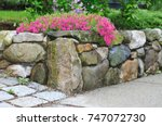 natural stone wall and pink... | Shutterstock . vector #747072730
