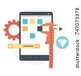 mobile app development.... | Shutterstock .eps vector #747073378