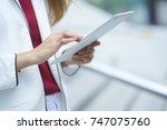 closeup businesswoman swipe on... | Shutterstock . vector #747075760
