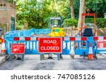 street barricaded with road... | Shutterstock . vector #747085126