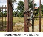 a new locks and a rusty locks... | Shutterstock . vector #747102673