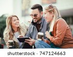 group of smiling friends with... | Shutterstock . vector #747124663