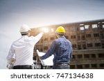 construction engineers... | Shutterstock . vector #747134638