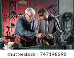a young apprentice adjusting a... | Shutterstock . vector #747148390