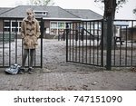 sad girl at school gate... | Shutterstock . vector #747151090