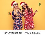 christmas new year. two young... | Shutterstock . vector #747155188