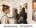 Stock photo group of woman looking at modern painting in art gallery abstract painting 747162670
