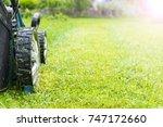 mowing lawns  lawn mower on...   Shutterstock . vector #747172660