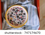 bowl of cereal porridge and... | Shutterstock . vector #747174670