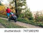 running mother with child in... | Shutterstock . vector #747180190