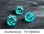 risk concept   playing dice at... | Shutterstock . vector #747184810