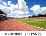 blurred red running track on...   Shutterstock . vector #747192700
