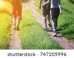 Group Of Young Hikers Walking...