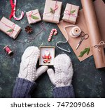 woman hands in mittens packing... | Shutterstock . vector #747209068