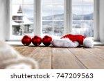desk and winter window  | Shutterstock . vector #747209563