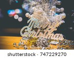 the white christmas tree with... | Shutterstock . vector #747229270